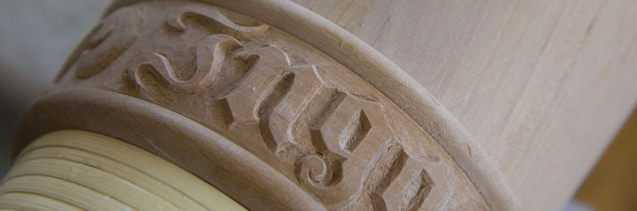 Hand carving detail on an Alphorn - traditional typography